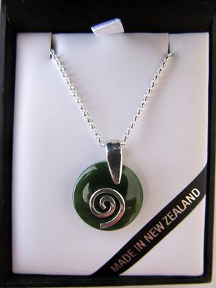 NN5023 Mana NZ Smooth round greenstone pendant with silver koru.